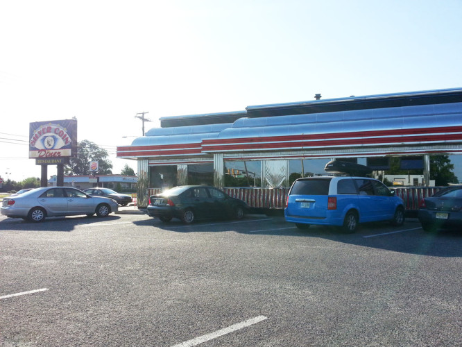 Admiring our sexy R2D13 van parked at the diner